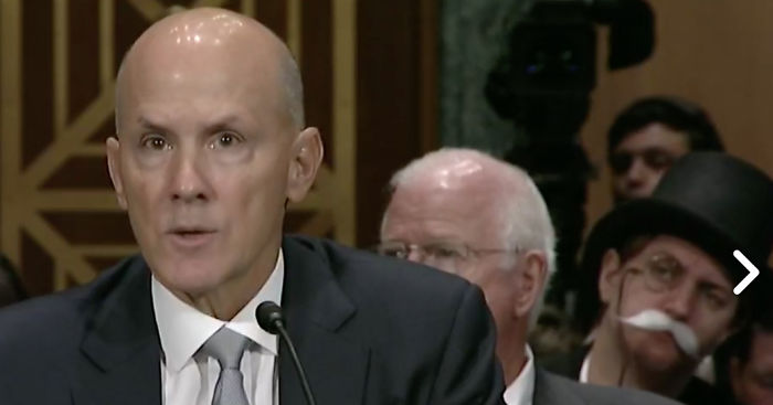Monopoly Man In Background During Equifax Senate Hearing