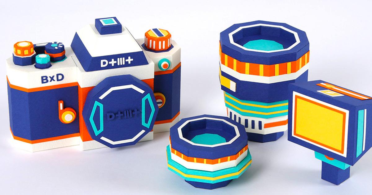 Uma câmera de papel composta de cores complementares que inclui lentes intercambiáveis e um flash removível